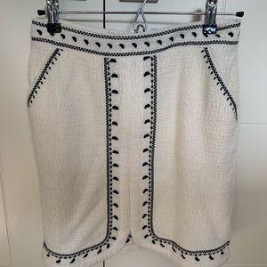 Embroidered Anthropologie skirt.
